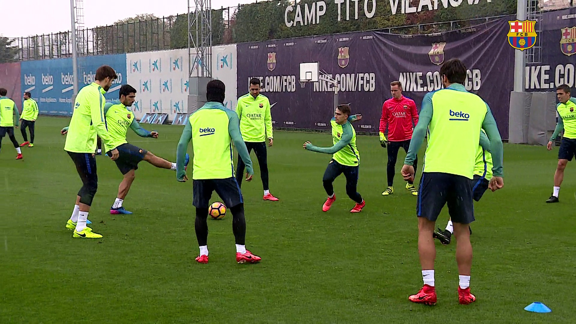 FC Barcelona training session: Working out under the rain